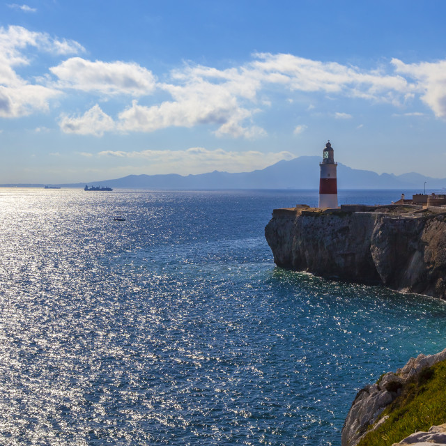 """""""Lighthouse of Europa Point in Gibraltar overlooking the Strait with Morocco in background."""" stock image"""