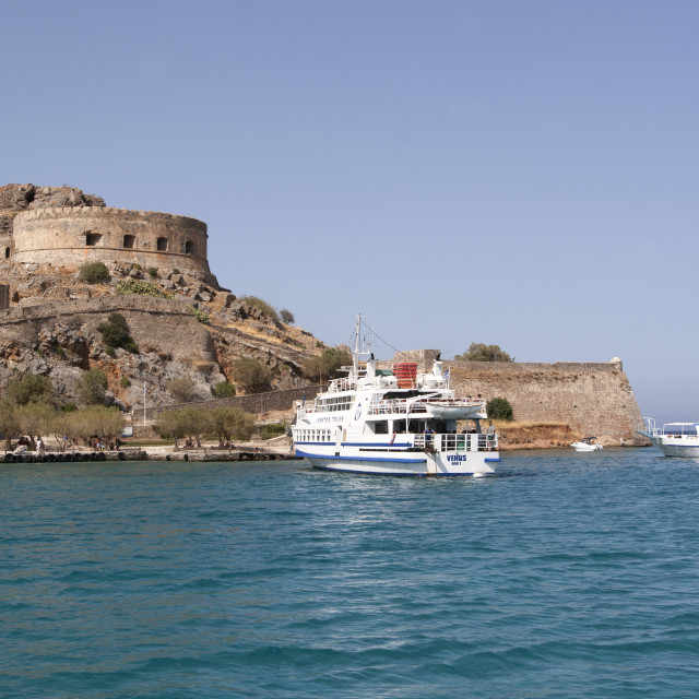 """Tourist Boats Visit the Island of Spinalonga"" stock image"