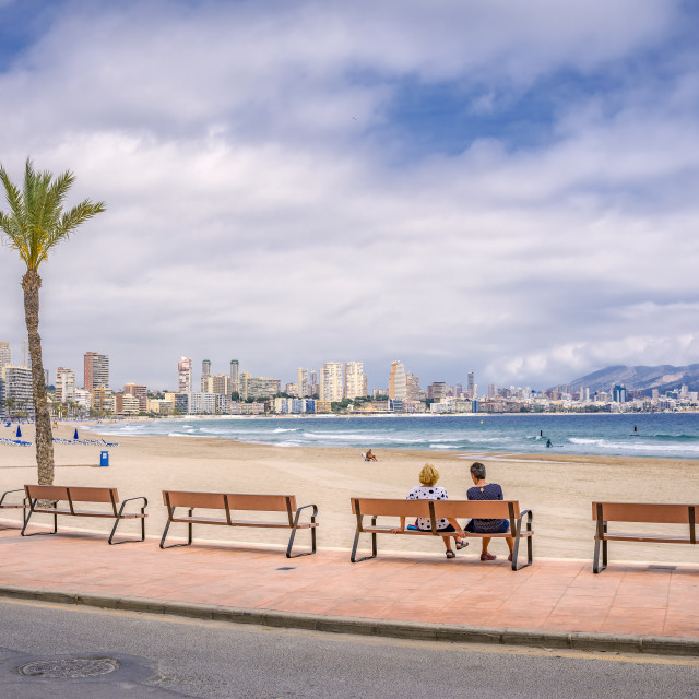 """Two ladies sit admiring the view at Benidorm."" stock image"