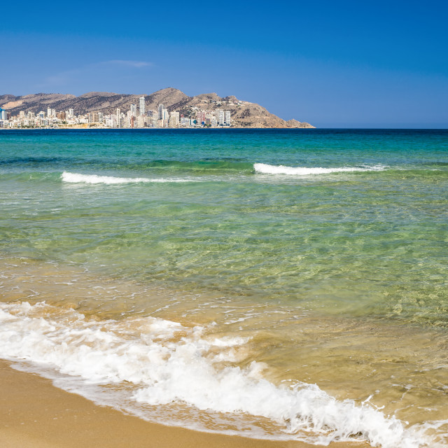 """Waves lapping the shore on a Benidorm beach."" stock image"