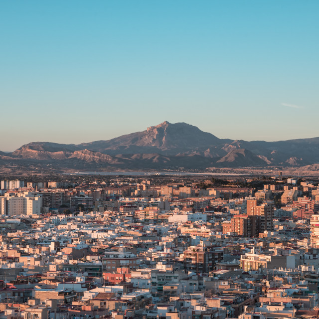 """Aerial view of Alicante town with mountains in the background."" stock image"