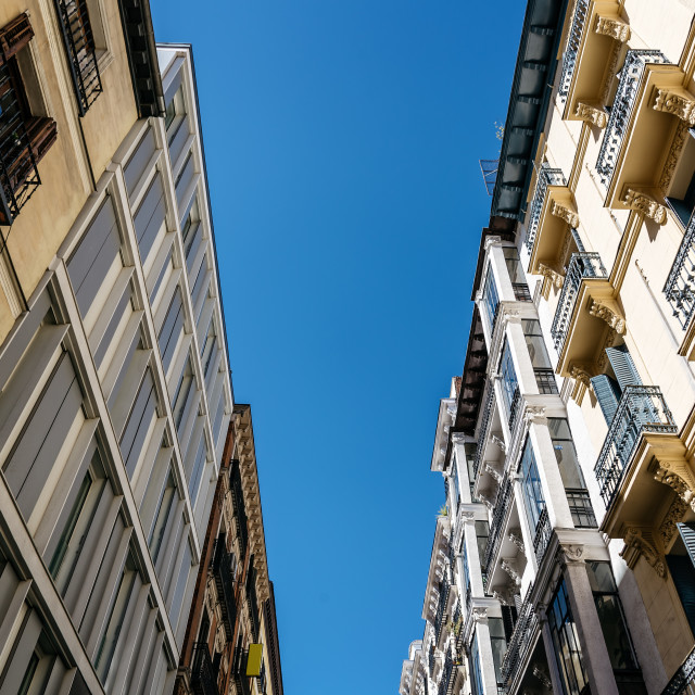"""Low angle view of residential buildings in city centre"" stock image"
