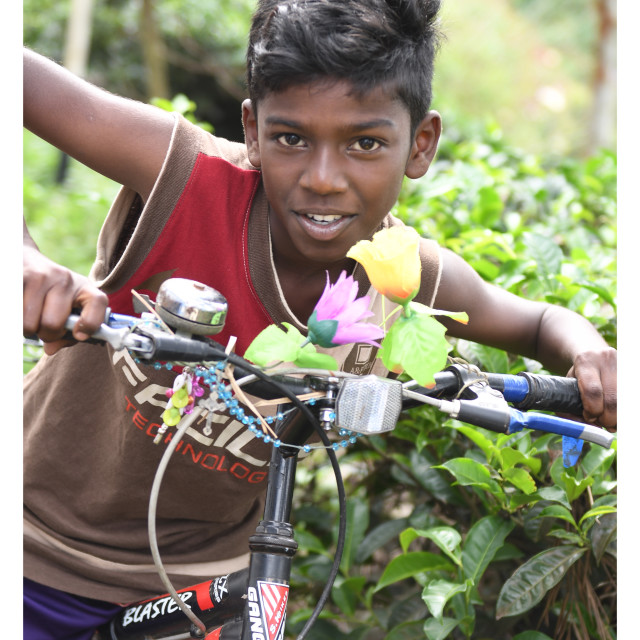 """India boy on a bike"" stock image"