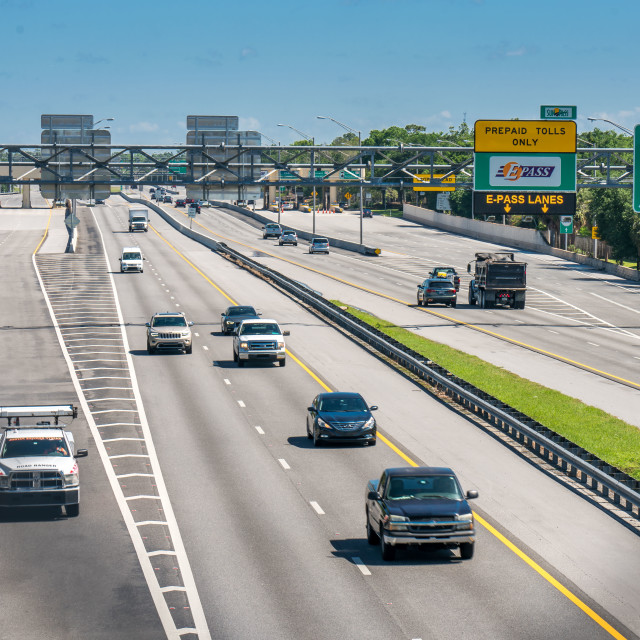 """""""Orlando area highway and toll road 417 looking North bound. Midday traffic. Sunny spring day in Central Florida."""" stock image"""