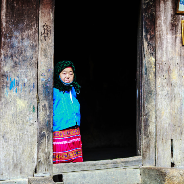 """""""DONG VAN, HA GIANG, VIETNAM, January 1th, 2018: Hmong family sitting on over house in during the travel HA GIANG district North VIETNAM an area adjacent to CHINA."""" stock image"""