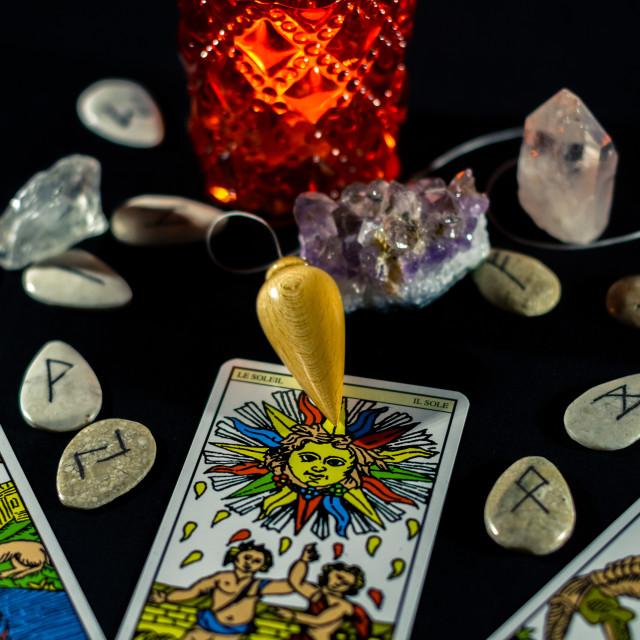 """""""Dowsing Pendulum with Tarot & Runes"""" stock image"""