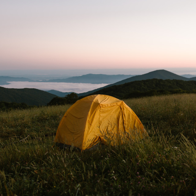 """""""Tent Camping on Top of a Mountain At Dawn"""" stock image"""