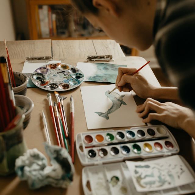 """Artist Painting with Watercolors in Art Studio"" stock image"
