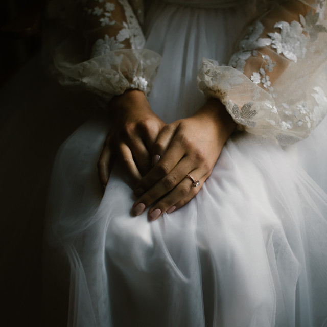 """Bride's Hands Waiting on Her Wedding Day"" stock image"
