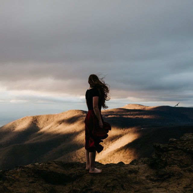 """Woman Standing on Top of A Mountain"" stock image"