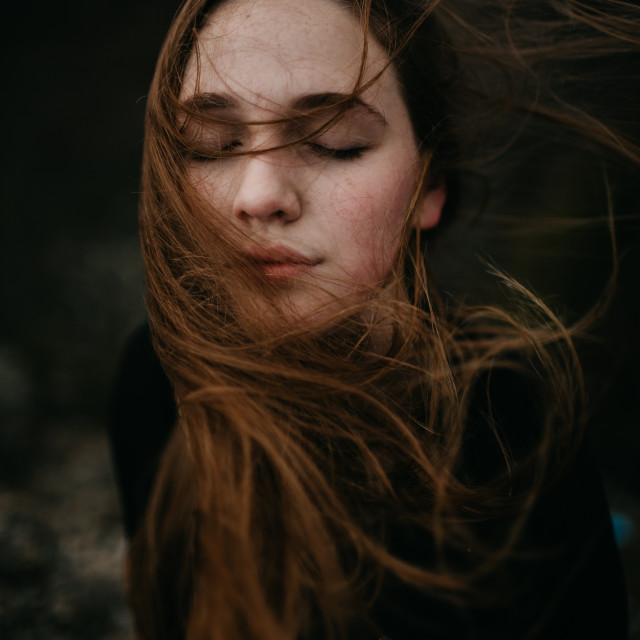 """""""Young Woman With Wind Blowing Her Hair"""" stock image"""