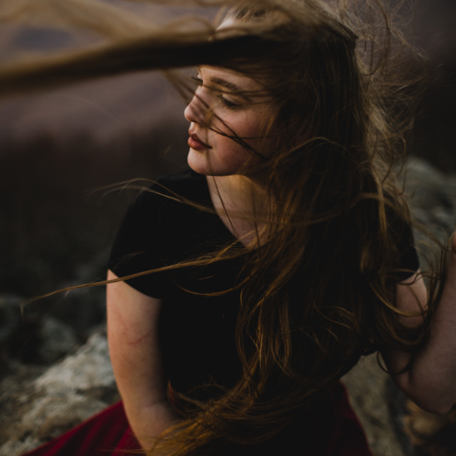 """Young Woman With Wind Blowing Her Hair"" stock image"