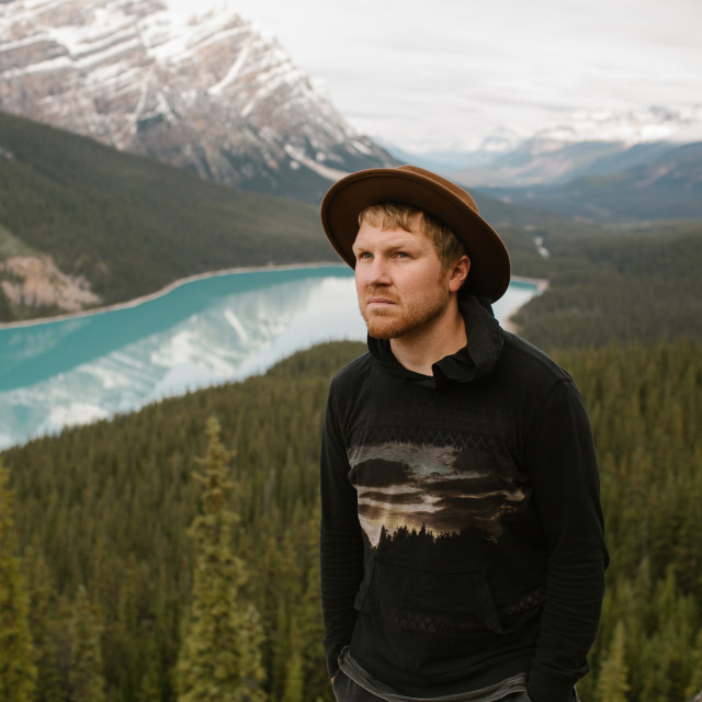 """""""Hipster Hiker wearing a Hat"""" stock image"""