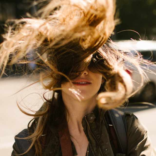 """Woman With Hair Blowing in the Wind"" stock image"