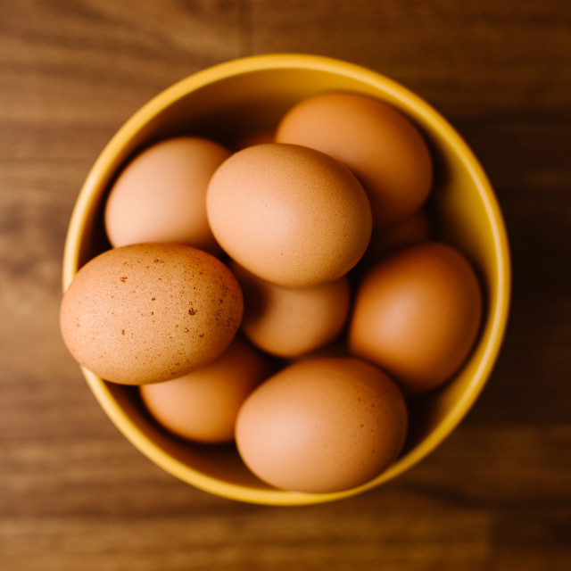 """Brown Eggs in Yellow Bowl"" stock image"