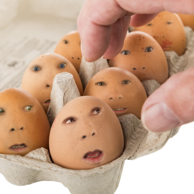 """box of eggs with faces"" stock image"