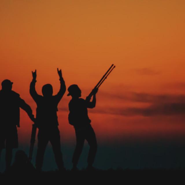 """Photographers at Sunset"" stock image"