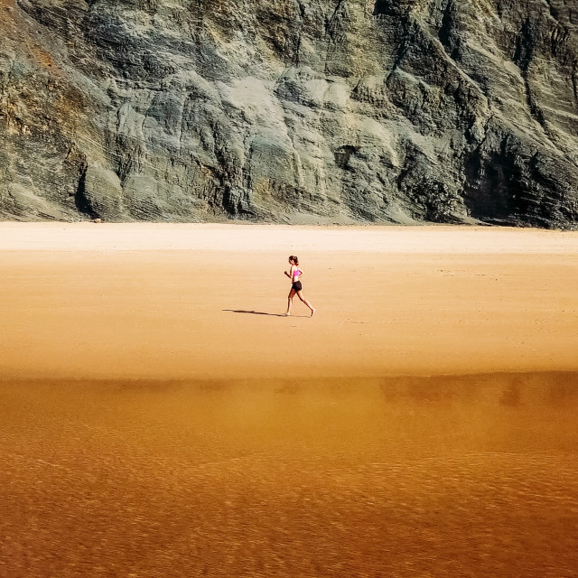 """""""Aerial Drone View Of Healthy Sportive Woman Running On Beach Near Ocean"""" stock image"""