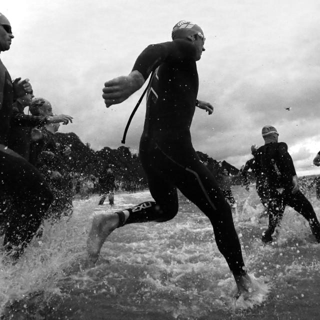 """Ironman Competitors starting the swim"" stock image"