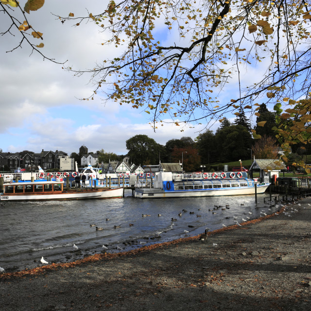 """Autumn, the tourist cruise boats at Bowness-on Windermere Pier, Cumbria, UK"" stock image"