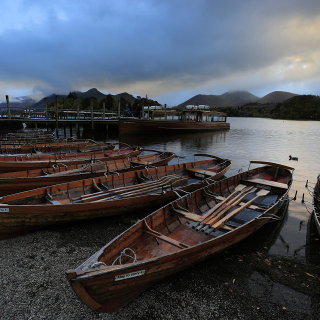 """Sunset over the wooden rowing Boats on Derwentwater Lake, Keswick town,..."" stock image"