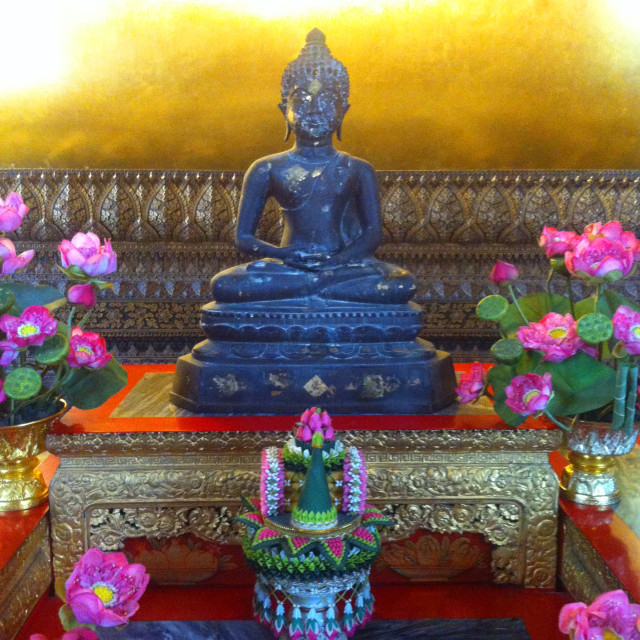 """""""A small Buddhist statue at Wat Pho"""" stock image"""