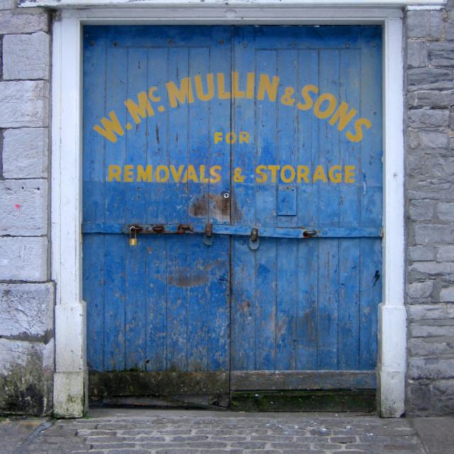 """""""Old sign written warehouse door"""" stock image"""