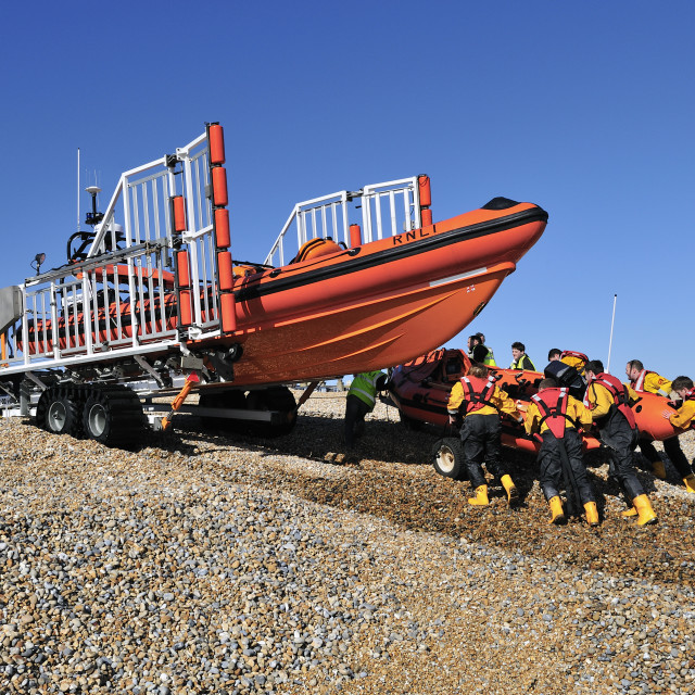 """retrieving lifeboat from the sea"" stock image"