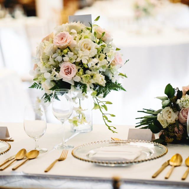 """The bouquet on the bride table during wedding reception dinner"" stock image"