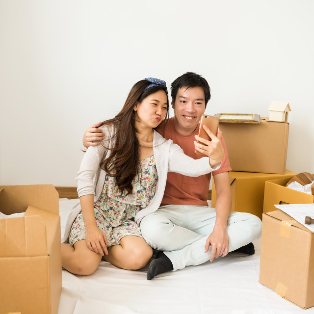"""happy couple selfie in new home"" stock image"