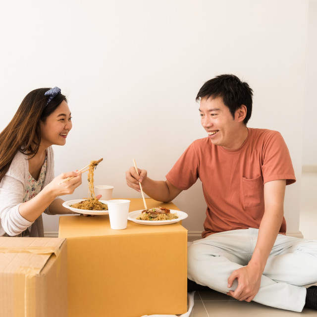 """couple eat noodle at new moving house"" stock image"