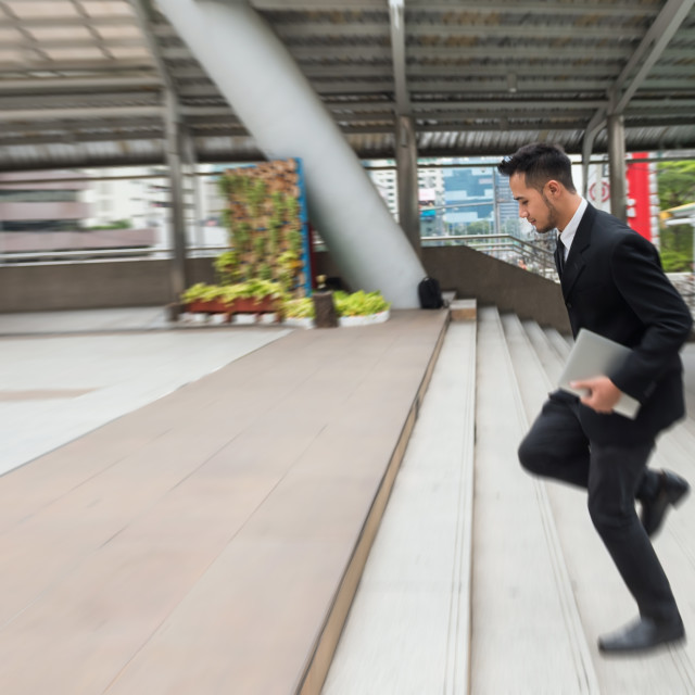 """Businessman running in hurry at town"" stock image"