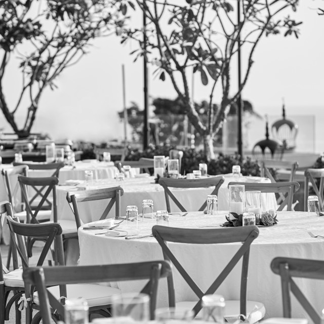 """Wedding reception dinner table setting with folding lawn chairs in Black and White"" stock image"