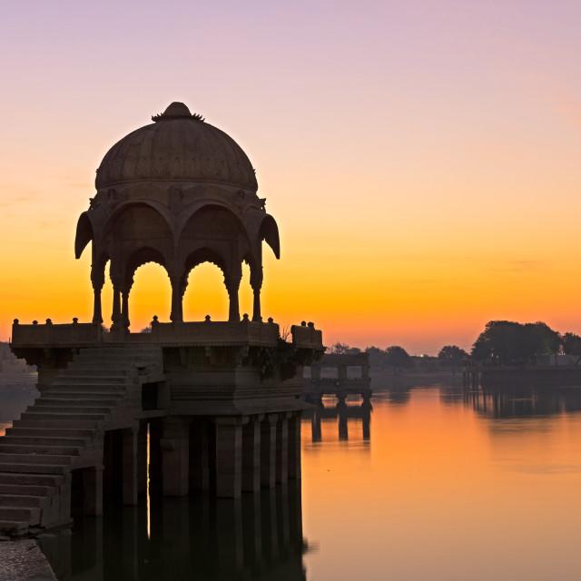 """Sunrise over Gadi Sagar Temple in Gadisar lake"" stock image"
