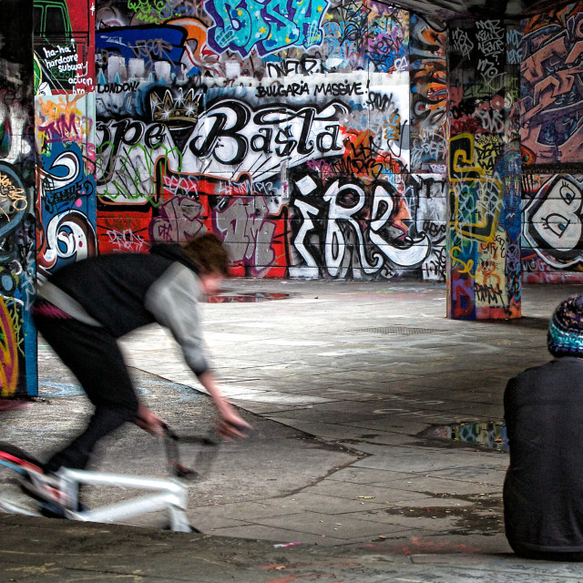 """Cyclist and Skateboarder on South Bank"" stock image"