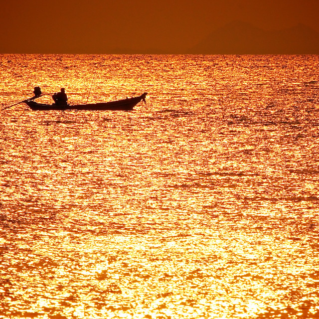 """Thai Longboat at Sunset"" stock image"