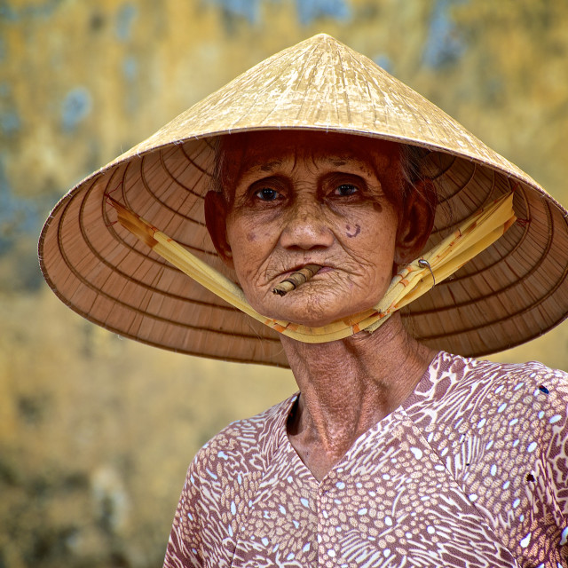 """Vietnamese Lady with cigar"" stock image"