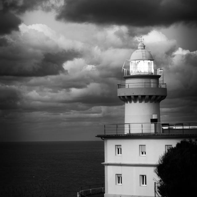 """lighthouse at nightfall"" stock image"