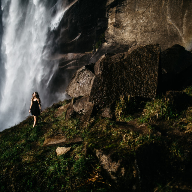 """woman standing under a waterfall"" stock image"