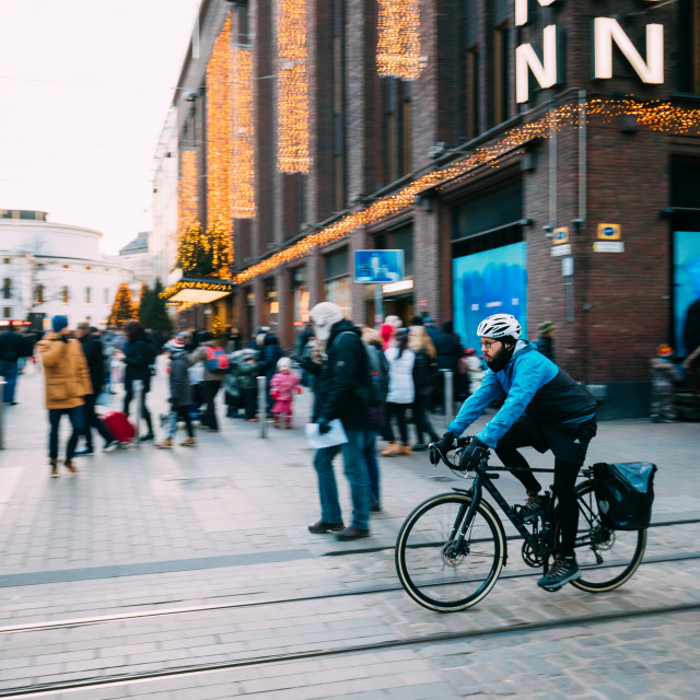 """""""Helsinki, Finland. Man Riding Bicycle Near Stockmann Department Store On..."""" stock image"""