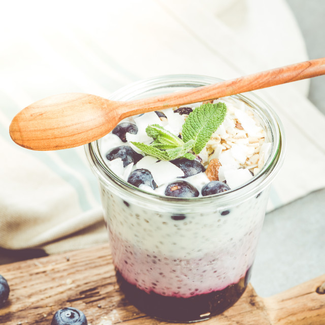 """""""Blueberry and coconut musse layered in jar"""" stock image"""