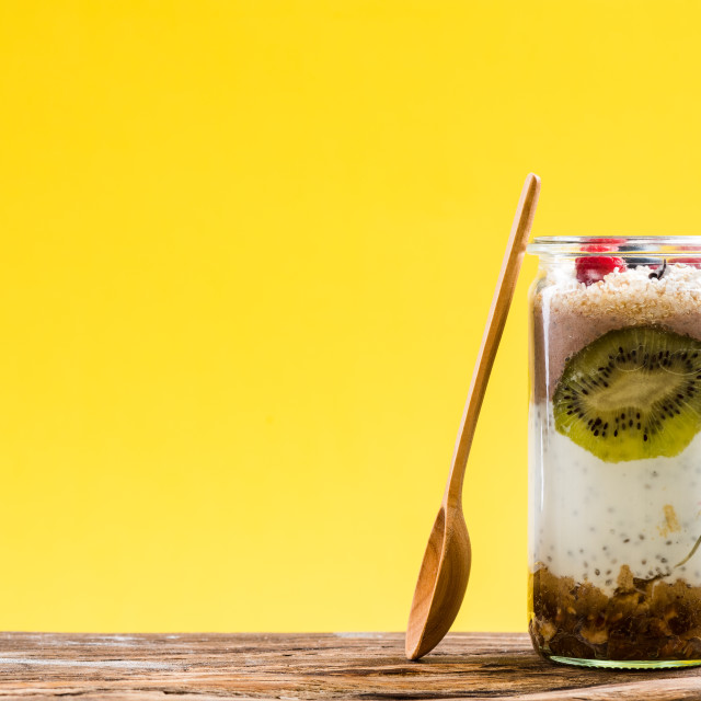 """""""Layered parfait with chia,spirulina and fruits"""" stock image"""