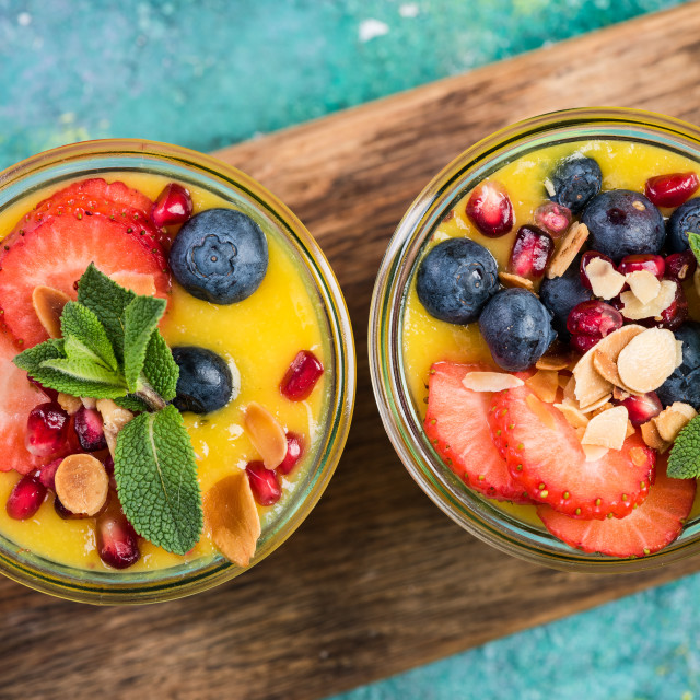 """""""Mixed fresh fruits and mango pulp dessert in jar"""" stock image"""