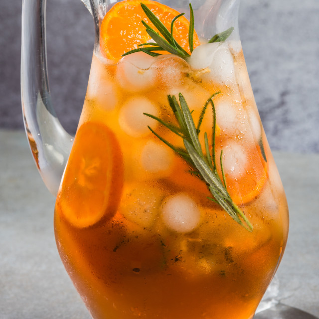 """""""Ice cold tea with rosemary in pitcher"""" stock image"""