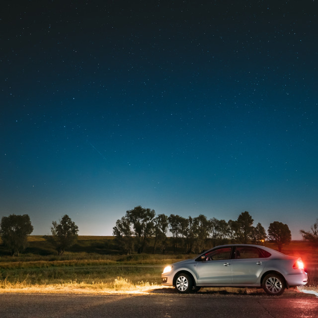 """""""Night Starry Sky Above Country Asphalt Road In Countryside. Sedan Car Parking..."""" stock image"""