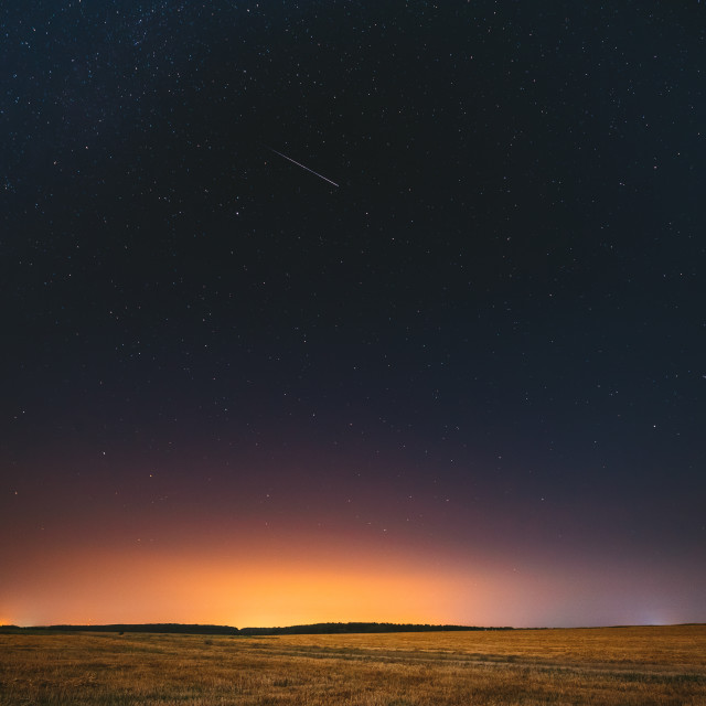 """""""Natural Night Starry Sky Above Field Meadow. Glowing Stars, Meteorite Trail..."""" stock image"""