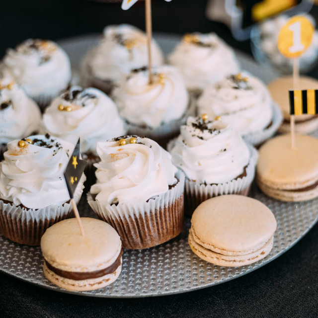 """""""Dessert Sweet Tasty Cupcakes And Macarons In Candy Bar On Table. Delicious..."""" stock image"""