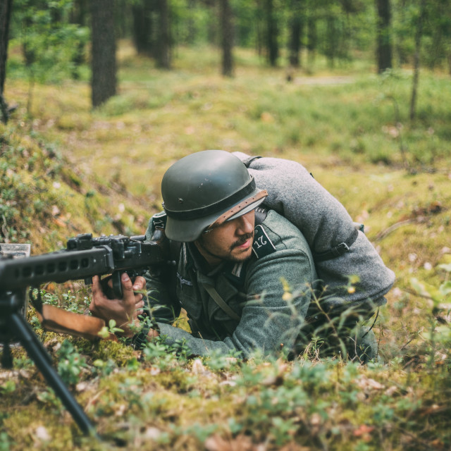 """Re-enactor Dressed As German Wehrmacht Infantry Soldier Machine-gunner In..."" stock image"