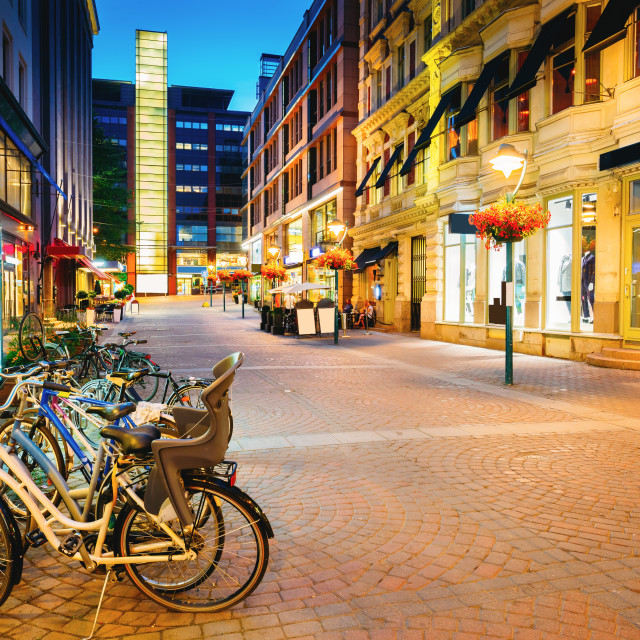 """Helsinki, Finland. Bicycles Parked Near Storefronts In Kluuvikatu Street...."" stock image"
