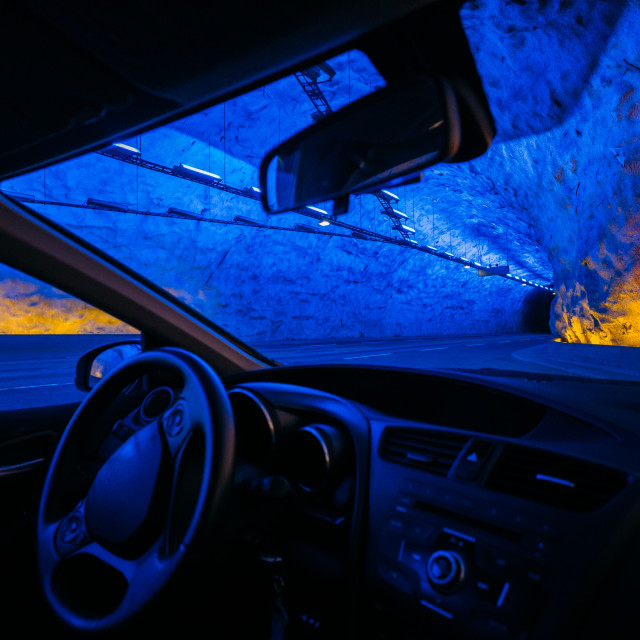 """Road On Illuminated Tunnel In Norwegian Mountains. View From Car"" stock image"